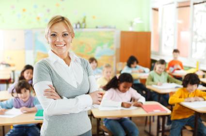 Smiling teacher at the school class.